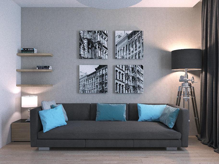 На фотографіЇ сірий диван з блакитними подушками,коло дивана світильники,на стіні чорно-білі фотографіЇ.